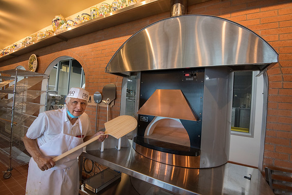200728 DiCamillo 4<br /> James Neiss/staff photographer <br /> Niagara Falls, NY - Tom DiCamillo shows off the pizza oven for heating up the famous DiCamillo pizza at the newly redesigned DiCamillo Bakery store.