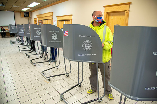 201103 Election Day 2<br /> James Neiss/staff photographer <br /> Lockport, NY -Philip Smeader heads to the scanner after marking his ballot at the South Lockport Fire Hall voting site.