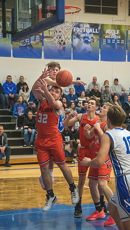 James Neiss/staff photographer <br /> Newfane, NY - Newfane #1 Sam Capen blocks a shot by Wilson #32 Brayden Thompson during basketball game action in Newfane.