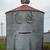 201105 Enterprise 3<br /> James Neiss/staff photographer <br /> Sanborn, NY - Don't Blink - Many of you probably drove right past this whimsical display of a chicken sitting on top of a smiling silo along Buffalo Street in Sanborn. If so, you were cheated out of a smile. This is just one of the many things that make Niagara County a nice place to live.