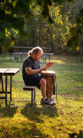 "200924 Wilson PP 7<br /> James Neiss/staff photographer <br /> Wilson, NY -  Self described hippy Rob Peacock of Niagara Falls gets into a grove playing the bongos at Wilson Tuscarora State Park.  ""I'm an old hippy, I come down here to just breath."" It's beautiful here, a great place to relax. I just took a picture of swans swimming in the lake so my friends will believe me when I tell them about it."""