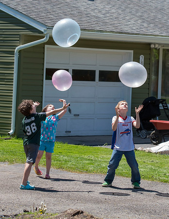 200520 Enterprise B<br /> James Neiss/staff photographer <br /> Lewiston, NY - Wubble Bubble Ball was the name of the game at the Boddecker home on Mohawk Street as siblings Cooper, 8, Piper, 6 and Jack, 9, play together in their front yard.