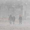 200509 May Snow 1<br /> James Neiss/staff photographer <br /> Niagara Falls, NY - Tourists leave Niagara Falls State Park amidst a white out snow storm. Fortunately it only lasted a few minutes.