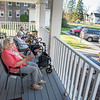 201110 Enterprise<br /> James Neiss/staff photographer <br /> Lockport, NY - Social Distant Concert - Residents at the Lockport Presbyterian Home clap along with performer Judd Sunshine during an afternoon outdoor concert.