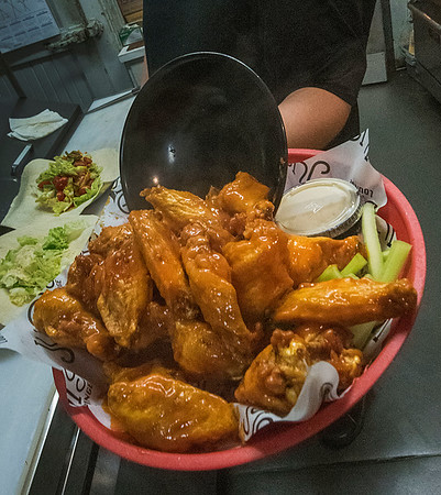 James Neiss/staff photographer <br /> Niagara Falls, NY - Judi's Lounge Bar & Grill at 2057 Military Road, has plenty of chicken wings and blue cheese on hand for Superbowl Sunday. Super Bowl Sunday is known for being the biggest day of the year for chicken wings and pizza consumption.