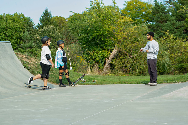 200915 Skateboard instructor 2<br /> James Neiss/staff photographer <br /> Niagara Falls, NY - Fourteen year skateboarding veteran Mike Brinson of Niagara Falls turned his passion into a business teaching others how to skateboard. Here, Brinson works with students Serena Clark and Kaylin Owens, both 12.