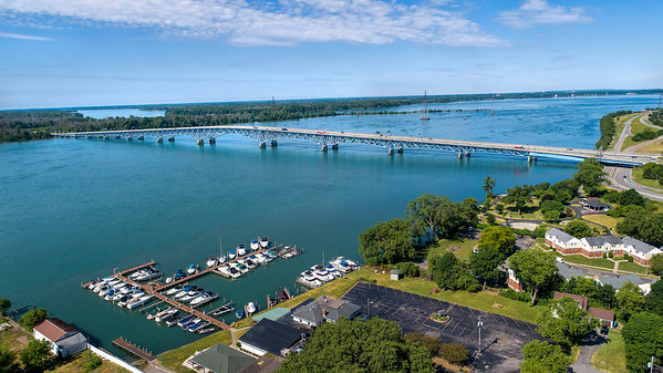 200625 Enterprise 3<br /> James Neiss/staff photographer <br /> Niagara Falls, NY - Summer Time View - The docks are all full at the LaSalle Yacht Club and LaSalle Waterfront Park is all spruced up on a beautiful summer day in Niagara Falls in this aerial of the North Grand Island Bridges and Niagara River.