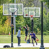 200914 Gill Creek 1<br /> James Neiss/staff photographer <br /> Niagara Falls, NY - Young men practice their moves at the new Gill Creek basketball court. Dignitaries and city officials held a ceremonial ribbon cutting officially opening the courts.