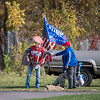 201014 Singing Trump 2<br /> James Neiss/staff photographer <br /> Niagara Falls, NY - Vincent Crampton has been dressing up as Donald Trump and singing his praise to passing traffic on Porter Road. Here he gets a supportive knuckle bump from neighbor Michelle Hafii.