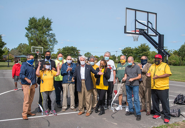 200914 Gill Creek 2<br /> James Neiss/staff photographer <br /> Niagara Falls, NY - Dignitaries and city officials held a ceremonial ribbon cutting officially opening the Gill Creek basketball court.