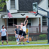 200625 Enterprise 1<br /> James Neiss/staff photographer <br /> Lockport, NY - The nets are on and it appears the gloves are off for basketball game action at Dolan Park.