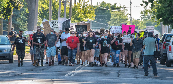 2006017 Justice for Troy 1<br /> James Neiss/staff photographer <br /> Lockport, NY - Marching up Park Avenue, protesters seek justice for Troy Hodge on the anniversary of his death June 19, 2019, while in police custody.