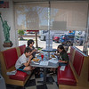 2006016 Inside Dining 1<br /> James Neiss/staff photographer <br /> Lockport, NY - Giancarlo Pari, 10, his mother Grace and sister Julia, 16, enjoy a sitdown breakfast at Tom's Diner in Lockport. On Tuesday New York State entered Phase 3 of reopening during the COVID-19 pandemic which includes inside dining at 50% capacity.