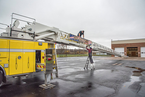 201111 Enterprise<br /> James Neiss/staff photographer <br /> Wheatfield, NY - Crew Chief Nick Ackerley and Inspector Rachel Bulau with American Test Center, perform an annual inspection of a 109 foot ladder truck at the Shawnee Volunteer Fire Company.