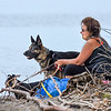 200527 Enterprise 2<br /> James Neiss/staff photographer <br /> Wilson, NY - Jen Ernest of Wilson headed to the shores of Lake Ontario at Tuscarora State Park to enjoy the cool breezes with her dogs Gabby and Chloe on a hot day.