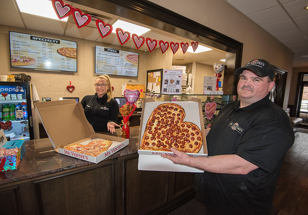 James Neiss/staff photographer <br /> Niagara Falls, NY - Mr. Ventry's Pizzeria and Restaurant is all about love this Valentine's  as employees Carolyn Sobol and Shawn Chafin show off heart shaped pizza and chicken wing bouquets you can purchase for your loved one.
