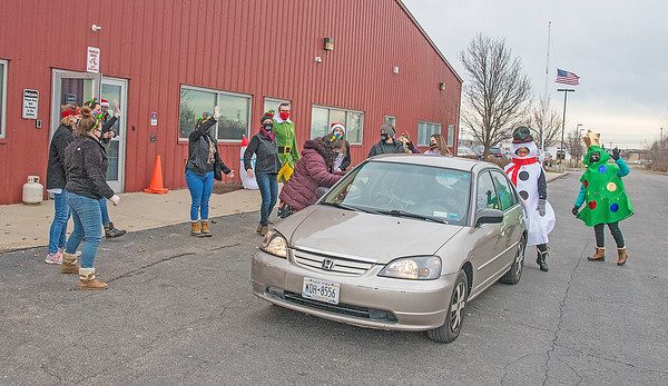 201216 Niagara Charter 2<br /> James Neiss/staff photographer <br /> Town of Niagara, NY - With loud holiday music blasting faculty and staff at Niagara Charter School deliver gift bags in drive-thru style.