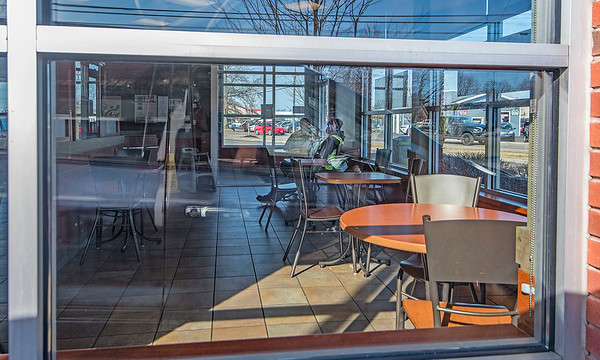 200316 Virus - Social Distancing 1<br /> James Neiss/staff photographer <br /> Niagara Falls, NY - The typical morning crowd of people socializing and drinking coffee at the Tim Hortons in Bergholtz was unusually quiet as the public practiced social distancing. Movie theatres, bars and restaurants have been ordered to close their doors to the public at 8 p.m.