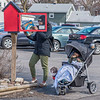 James Neiss/staff photographer <br /> Lockport, NY - Jhahiva and little Jhune Jackson stopped to find a good book to read at the Little Free Library outside the Emmanuel United Methodist Church with Super Jackson the dog at their side.