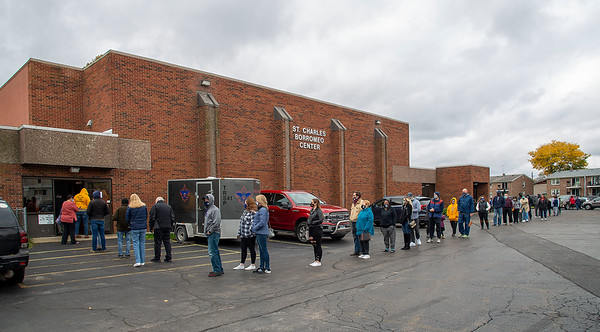 201025 Early Voting 2<br /> James Neiss/staff photographer <br /> Niagara Falls, NY - Early voters line up at St. John de Lasalle Church St. Charles Borromeo Center to vote on Sunday.