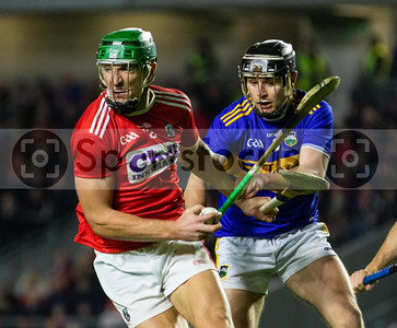 Cork's Aidan Walsh gathers the ball with Tipperary's Alan Flynn in attendence
