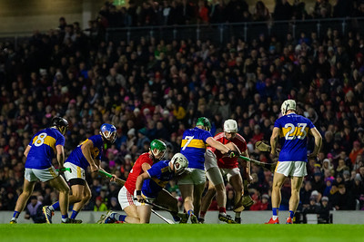 Tipperary and Cork players fight for the ball in Pairc Ui Chaoimh