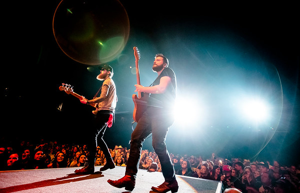 Matt Helmkamp (right) and Christian Sancho (left) walk away from the crowd during Ashley McBryde's performance at Mizzou Arena. It was McBryde's. First time opening for Luke Combs on the What You See Is What You Get World Tour.