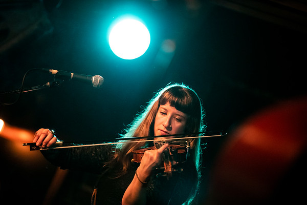 Ashley Mae, of Lost Dog Street Band, plays the fiddle on stage at the Blue Bird Night Club. The concert would be the last of the groups before the lockdowns from Covid-19.