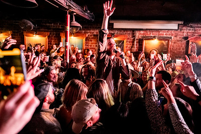 Brandon Lancaster, of the country group Lanco, reaches for the crowd while performing a song on a step stool on March 6. Lanco sold the Blue Bird Night Club out as apart of their international tour.