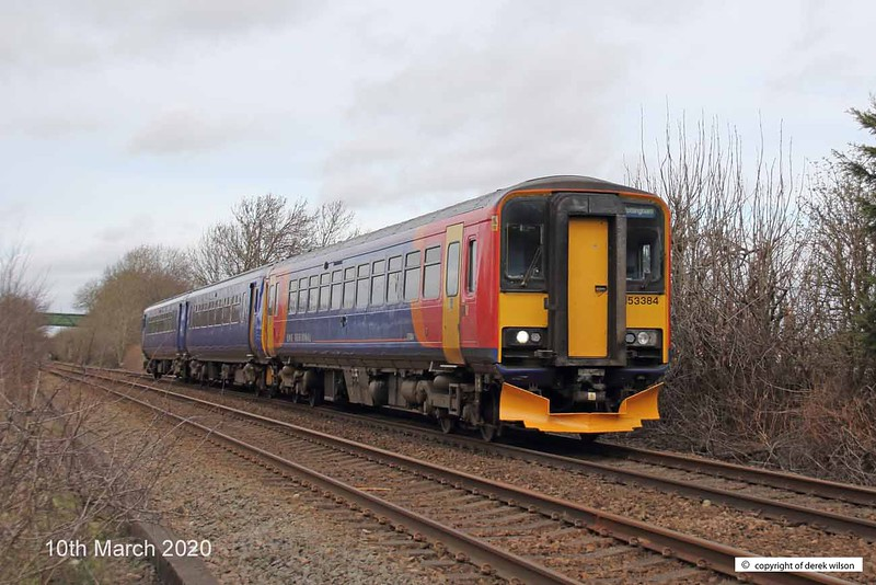 200310-001  East Midlands class 153 unit No. 153384, in tandem with 156414 is seen passing Vale Road, Mansfield Woodhouse, with 2D10, the 11:38 Worksop - Nottingham.