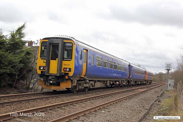 200310-002  East Midlands class 153 unit No. 153384, in tandem with 156414 is seen passing Vale Road, Mansfield Woodhouse, with 2D10, the 11:38 Worksop - Nottingham.