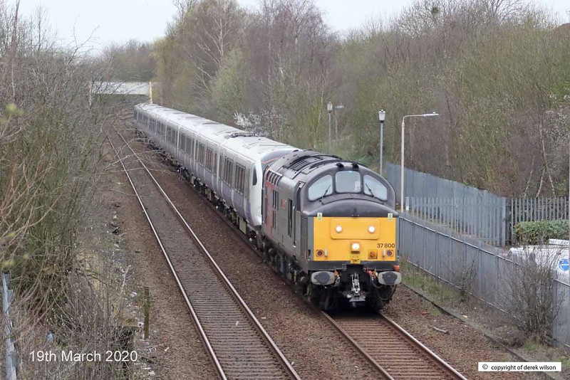 200319-001  Rail Operations Group class 37 No. 37800 Cassiopeia is seen passing Tenter Lane, Mansfield, on the Robin Hood Line, powering train 5Q26, 13:31 Old Dalby - Worksop Down Yard. In tow is Crossrail class 345 EMU No. 345002, heading to Worksop for 'warm' storage.