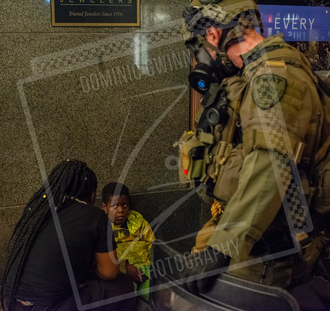 Child recieves first-aid during Chicago riots