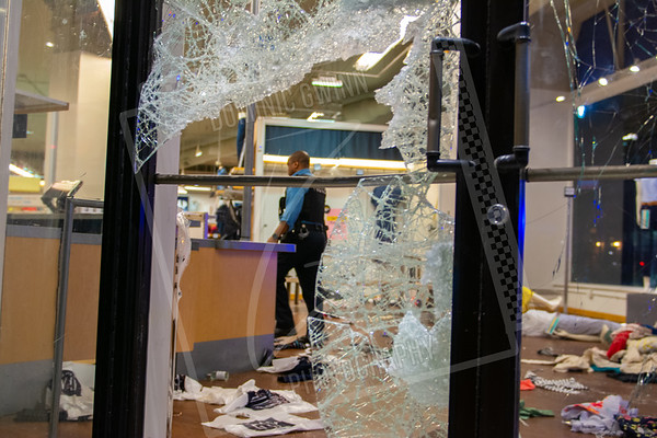 Police officer inspects looted store