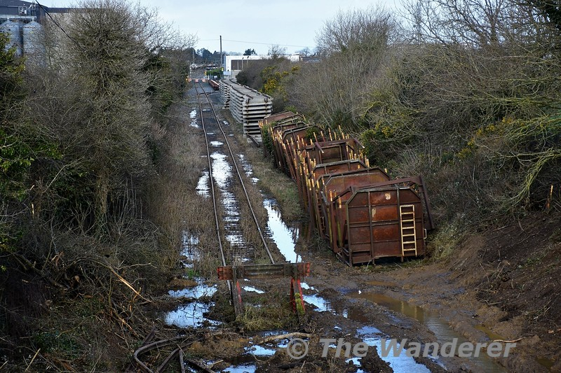 The stub of the former Coolnamona branch in Portlaoise is being extended for approx 1/4 mile to allow the installation of a test track for the PWD Yard. This section of line last saw use in 1996 when Beet Wagons were stored on this section. The track was lifted in 1997 from Togher Level Crossing around Milepost 2 back to Milepost 1 where a buffer stop was erected. Part of the trackbed was severed for the construction of the M7 Portlaoise Bypass which is about 500 metres further on from the end of the cleared section of trackbed. The buffer stop which was placed here in 1997, old timer wagons timber wagon stanchions and beyond them the track panels which will be used for relaying the extended headshunt. Thurs 20.02.20