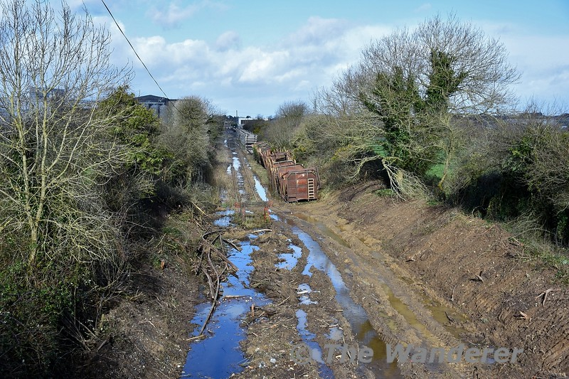 The stub of the former Coolnamona branch in Portlaoise is being extended for approx 1/4 mile to allow the installation of a test track for the PWD Yard. This section of line last saw use in 1996 when Beet Wagons were stored on this section. The track was lifted in 1997 from Togher Level Crossing around Milepost 2 back to Milepost 1 where a buffer stop was erected. Part of the trackbed was severed for the construction of the M7 Portlaoise Bypass which is about 500 metres further on from the end of the cleared section of trackbed. This view looks towards Portlaoise PWD Yard. Thurs 20.02.20