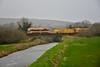 073 crosses the swollen Kilmustulla River at Kilnacranna with the 0825 Limerick - Ballybrophy Sperry Train. Fri 21.02.20