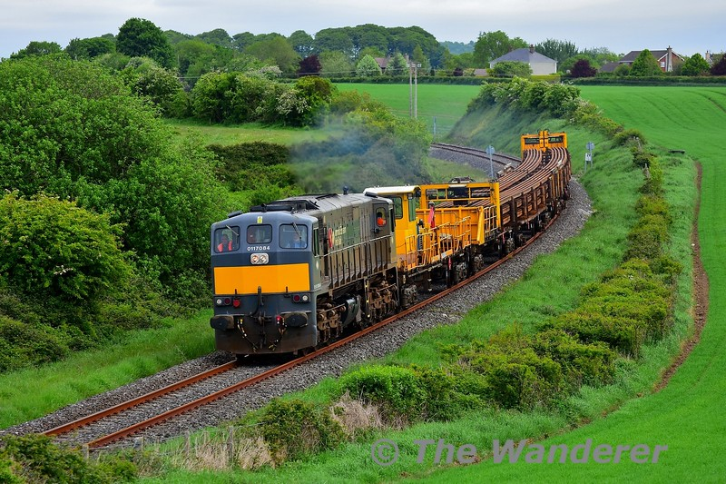 On Tuesday 19th May, a CWR train operated over the Nenagh Branch to drop rails between the 26MP and 28MP. The train entered the possession at Ballybrophy shortly after 0915 and proceeded to Birdhill for the locomotive to run around. Here we see 084 passing Lisbunny on the outskirts of Nenagh with the CWR train bound for Birdhill. Tues 19.05.20