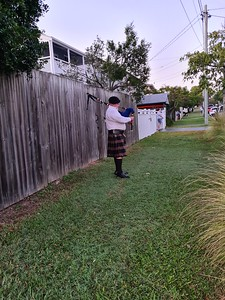 6.00am Jak takes a photo of Matt playing the bagpipes while other members of the public join in the 'Light up the Dawn' from their driveway
