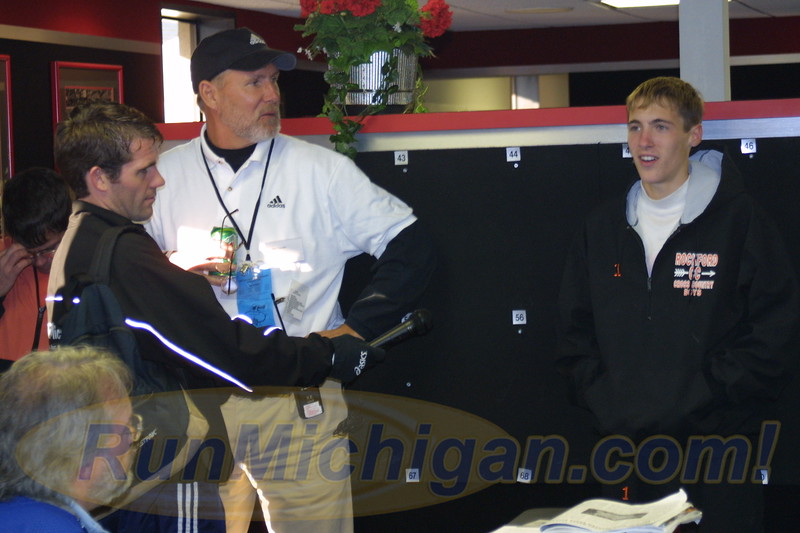 Dathan Ritzenhein being interviewed after the meet at the 2000 MHSAA LP XC Boys' D1 Finals at MIS on November 4, 2000. (Photo by John Brabbs)