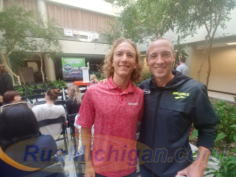 Dathan Ritzenhein poses with Parker Stinson at the pre-race media gathering ahead of the 2019 Crim 10 Mile in Flint, Michigan on August 22, 2019. (Photo by Dave McCauley)