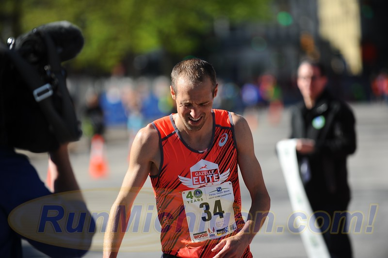 Dathan Ritzenhein crosses the finish line as first overall men's finisher in 1:14:26 at the 2017 River Bank Run 25K in Grand Rapids, Michigan on May 13, 2017. (Photo by Dave McCauley)