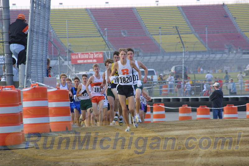 Dathan Ritzenhein leads the field out of the infield at the 2000 MHSAA LP XC Boys' D1 Finals at MIS on November 4, 2000. (Photo by John Brabbs)