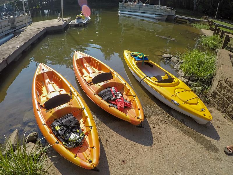 kayaks by lake shore in summer