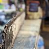 chainsaw chain shapening on shop table