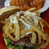 grilled bison meat burger sandwich and sweet potato waffle fries