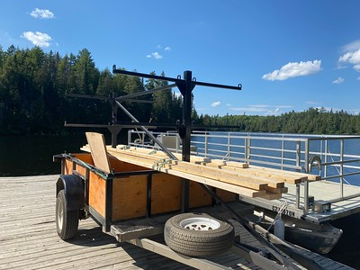 newly stained trailer with fresh lumber delivery