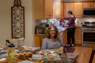 Mom and Daughter begin the annual Christmas cookie and candy bake. There's going to be lots of happy friends.