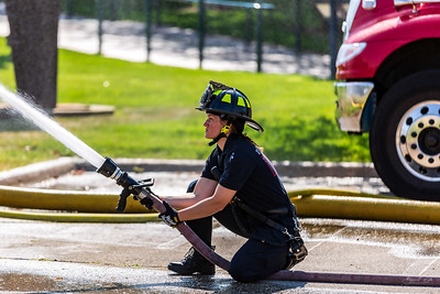 DA040,DJ_Firewoman_Trains_On_New_Fire_Truck_Equipment_at_Port_Of_Dubuque_