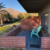 """Our motel-cabin, at """"Hacienda del Sol"""" in Borrego Springs. See moon."""